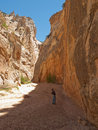 Man hiking in narrow desert canyon Royalty Free Stock Image