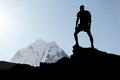 Man hiking silhouette in himalaya mountains male hiker with backpack on top of mountain looking at beautiful night mount ama Stock Photo