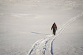 image photo : Man hiking in winter on a snow trail