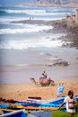 Man and his camel near taghazout surf village morocco a fishing agadir Royalty Free Stock Photography