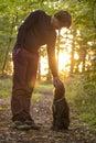 Man And His Dog Enjoying Nature