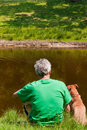 Man with his dog near the water Stock Photo