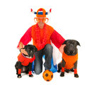 Man with his dogs as dutch soccer supporters laying colors and orange sweaters sports fans isolated over white background Royalty Free Stock Photo