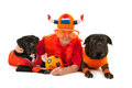 Man with his dogs as dutch soccer supporters laying colors and orange sweaters sports fans isolated over white background Stock Images