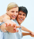 Man and his girlfriend stretching their hands Stock Photos
