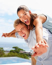 Man and his girlfriend stretching their hands Stock Photography