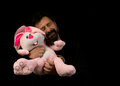Man with his plush toy holding tight rabbit Royalty Free Stock Image