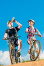Man and his wife on bicycles thirsty men Stock Photo