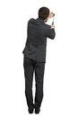 Man hitting nail in the wall rear view of businessman isolated on white background Royalty Free Stock Photos