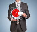 Man hold empty card and clockwork with flying Royalty Free Stock Photo