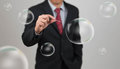 Man hold needle stab empty bubble an Stock Photography