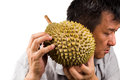 Man hold and shake durian fruit to assess its ripeness