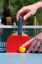 Man hold the tennis racket on pingpong table Stock Photography