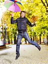 Man holding  autumn umbrella. Stock Photos