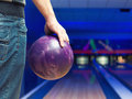Man holding ball against bowling alley Royalty Free Stock Image