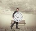 Man holding big clock Royalty Free Stock Photo