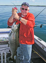 Man holding big lake ontario king salmon fish a picture of a a large a chinook or caught on near oswego new york Stock Photos