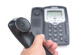 Man holding a black telephone receiver o white Royalty Free Stock Photo