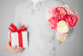 Man holding bouquet of flowers and gift box Royalty Free Stock Photo