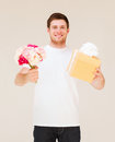 Man holding bouquet of flowers and gift box handsome Royalty Free Stock Photos