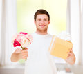 Man holding bouquet of flowers and gift box presents gifts celebration Royalty Free Stock Photos