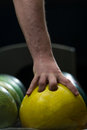 Man holding a bowling ball Royalty Free Stock Photo
