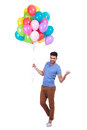 Man holding a bunch of balloons is inviting to party happy casual Stock Image