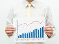 Man holding business financial graph chart Royalty Free Stock Images