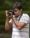Man holding camera Royalty Free Stock Photo