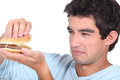 Man holding cheeseburger young a Royalty Free Stock Photos