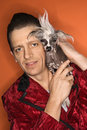 image photo : Man holding Chinese Crested dog.