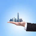 Man holding a city in hand business concept Stock Image