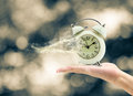 Man holding a clock in his hand And lost time Royalty Free Stock Photo