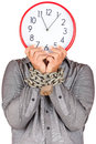 Man holding a clock in place of his face with his hands chained formally dressed witha metallic chain and padlock useful to Royalty Free Stock Photos