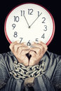 Man holding a clock in place of his face with his hands chained formally dressed witha metallic chain and padlock useful to Royalty Free Stock Image
