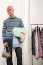 Man holding clothes and handbag Stock Photography