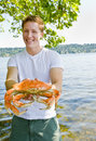 Man holding crab Royalty Free Stock Image