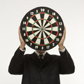 Man holding dartboard Royalty Free Stock Photography