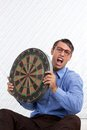 Man holding a dartboard retro styled Stock Photo