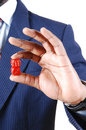 Man holding dice a black businessman two red in his hand in a blue suit standing isolated for white background Stock Images