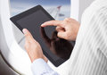 Man holding digital tablet at airplane businessman Royalty Free Stock Photo
