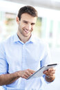 Man holding digital tablet portrait of confident business Stock Photos