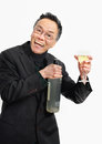 Man holding drink at business social with eye glasses a bottle and wine glass toasting a office party studio portrait white Royalty Free Stock Image