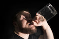 Man holding empty bottle of alcohol Royalty Free Stock Photo