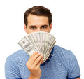 Man Holding Fanned Out Dollars In Front Of Face Royalty Free Stock Photo