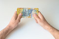 Man holding fifty Australian Dollar banknote Royalty Free Stock Photo