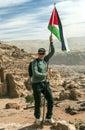 Man holding the flag of Jordan