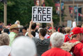 Man holding free hugs sign in crowd ottawa canada july a young offering during canada day on july downtown ottawa ontario Stock Photo