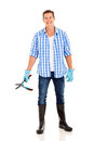 Man holding garden shears full length portrait of young Royalty Free Stock Photography