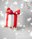 Man holding a gift box valentine s day christmas x mas winter happiness concept Royalty Free Stock Photography